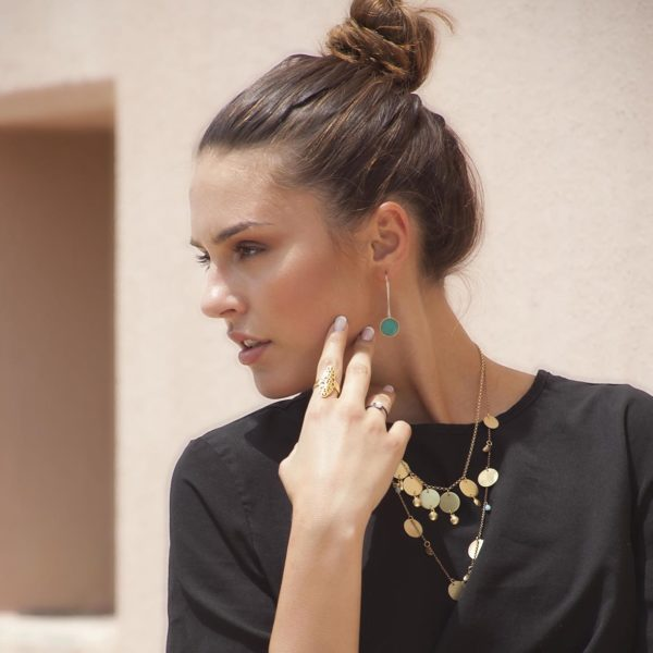 coin necklace worn