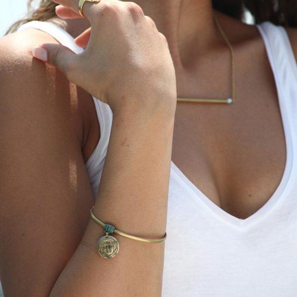 flip coin bracelet worn